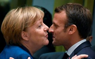German Chancellor Angela Merkel and French President Emmanuel Macron attend the European Union leaders summit in Brussels, Belgium October 17, 2018. REUTERS/Toby Melville