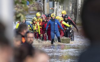 Rescue workers retrieve a body from floodwaters in the town of Trebes, southern France, Monday, Oct.15, 2018. Flash floods tore through towns in southwest France, turning waterways into raging torrents that killed at least 10 people, authorities said Monday. (AP Photo/Fred Lancelot)
