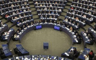 Members of the European Parliament take part in a vote in Strasbourg, eastern France, Wednesday, Sept.12, 2018. EU lawmakers have voted in favor of launching action against the Hungarian government of Prime Minister Viktor Orban for allegedly undermining the bloc's democratic values and rule of law. (AP Photo/Jean-Francois Badias)