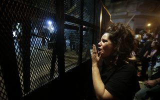 A protester makes noise along a fence cordoning off the Congress during a protest against a pension reform in Buenos Aires, Argentina, Tuesday, Dec. 19, 2017. Police and protesters clashed Monday outside Argentina's Congress as lawmakers debated the proposed pension overhaul that has angered retirees and prompted union leaders to wage a general strike. (AP Photo/Victor R. Caivano)