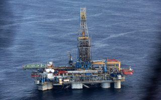 epa03010733 An aerial view from a helicopter of the Homer Ferrington rig operated by Noble Energy in the east Mediterranean, drilling in an offshore block on concession from the Cypriot government, 21 November 2011. Houston-based Noble started drilling for gas off Cyprus in September, in the island's first attempt to tap speculated offshore hydrocarbons deposits. Cypriot President Demetris Christofias visited the rig, which started drilling for gas on 21 November.  EPA/STR
