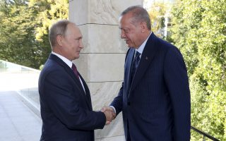 Russian President Vladimir Putin, left, welcomes Turkey's President Recep Tayyip Erdogan, right, prior to their meeting at the Bocharovy Ruchei residence, in Sochi, Russia, Monday, Sept. 17, 2018. The presidents met in the Russian Black Sea resort in a bid to find a diplomatic resolution to the crisis around a rebel-held region in Syria. (Presidential Press Service via AP, Pool)