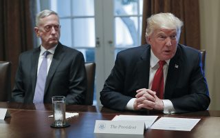 President Donald Trump speaks during a briefing with senior military leaders in the Cabinet Room of the White House in Washington, Thursday, Oct. 5, 2017, as Defense Secretary Jim Mattis listens. (AP Photo/Pablo Martinez Monsivais)