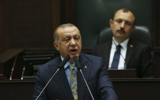 Turkey's President Recep Tayyip Erdogan addresses members of his ruling Justice and Development Party (AKP), in Ankara, Turkey, Tuesday, Oct. 23, 2018. Erdogan announced details of his country's investigation into the killing of Saudi writer Jamal Khashoggi, as skepticism intensified about Saudi Arabia's account that he died accidentally in its consulate in Istanbul.(AP Photo/Ali Unal)