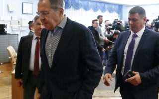 Russian Foreign Minister Sergey Lavrov, left, walks past a group of journalists after a Foreign and Defense Policy Council meeting in Moscow, Russia, Saturday, April 14, 2018. Russia's foreign minister says Moscow has received a document from a Swiss lab that analyzed the samples in the nerve agent poisoning of an ex-Russian spy, which points at a Western-designed nerve agent as a likely cause. (AP Photo/Pavel Golovkin)