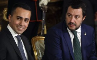 Leader of the League party, Matteo Salvini, right, sits by Luigi Di Maio, leader of the Five-Star movement, prior to the swearing-in ceremony for Italy's new government at Rome's Quirinale Presidential Palace, Friday, June 1, 2018. (AP Photo/Gregorio Borgia)