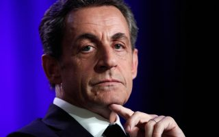 Former French President and conservative party UMP leader Nicolas Sarkozy attends a meeting in Asnieres, France, Tuesday March 24, 2015. The top two parties in weekend local elections were the conservative UMP and the far right National Front. (AP Photo/Thibault Camus)