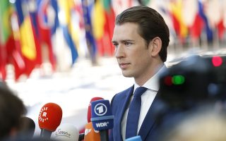 epa06849374 Austrian Chancellor Sebastian Kurz  speaks to media as he arrives for the European Council summit in Brussels, Belgium, 29 June 2018. The Twenty-Eight leaders of the European Union reached an agreement on the migratory issue at the end of the night, Friday, June 29 around 4:30, announced the President of the Council European Donald Tusk.  EPA/JULIEN WARNAND