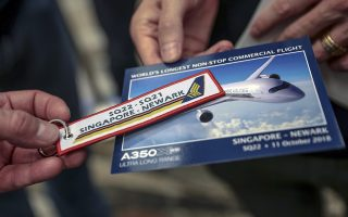 epa07086119 A commemorative keychain and postcard for Singapore Airlines flight SQ22 are seen in Singapore, 11 October 2018. Singapore Airlines (SIA) is restarting its SQ22 flight, a non-stop flight from Singapore Changi Airport to Newark Liberty International Airport, New Jersey, USA - just outside New York City - and will take about 18 hours and 45 minutes to cover 16,700km. It previously discontinued the service in 2013 due to high oil prices from operating the Airbus A340-500 and is restarting the flight using the newer Airbus A350-900ULR commercial jet. The flight eclipses the previous record of 17 hours and 40 minutes from Auckland, New Zealand to Doha, Qatar operated by Qatar Airways.  EPA/WALLACE WOON