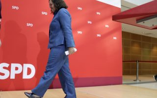 Andrea Nahles, chairwoman of the German Social Democratic Party SPD, leaves the podium afters a press conference in Berlin, Germany, Monday, Oct. 15, 2018 the day after the state elections in the German state of Bavaria. (AP Photo/Michael Sohn)
