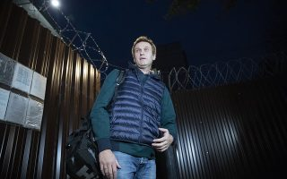 Russian opposition leader Alexei Navalny leaves a detention center in Moscow, Russia, Sunday, Oct. 14, 2018. (AP Photo/Pavel Golovkin)