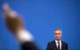 NATO's Secretary General Jens Stoltenberg listens to a question during a news conference following a meeting of NATO defence ministers at NATO headquarters in Brussels, Wednesday, Oct. 3, 2018. (AP Photo/Francisco Seco, Pool)