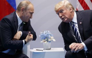 FILE - In this July 7, 2017, file photo, President Donald Trump meets with Russian President Vladimir Putin at the G-20 Summit in Hamburg. Trump signed on Aug. 2, what he called a