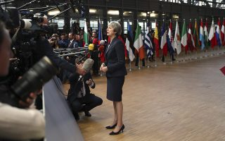 British Prime Minister Theresa May speaks with the media as she arrives for an EU summit in Brussels, Wednesday, Oct. 17, 2018. European Union leaders are converging on Brussels for what had been billed as a