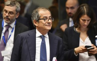 Italian Finance Minister Giovanni Tria, center, arrives for a round table meeting of eurogroup finance ministers at the European Council building in Luxembourg, Monday, Oct. 1, 2018. (AP Photo/Geert Vanden Wijngaert)
