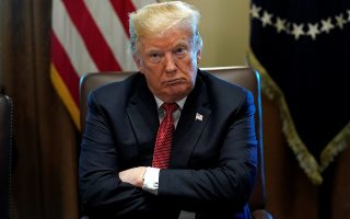 U.S. President Donald Trump looks up as he holds a Cabinet meeting at the White House in Washington, U.S., October 17, 2018. REUTERS/Kevin Lamarque