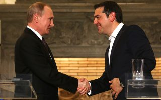 Greek Prime Minister Alexis Tsipras (R) shakes hands with President of the Russian Federation Vladimir Putin (L) after their meeting in Athens on 27 May 2016. VladimirPutin is in Greece on a two days visit.  EPA/ANA-MPA/ORESTIS PANAGIOTOU