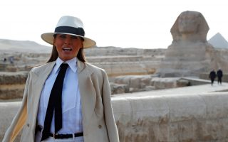 U.S. first lady Melania Trump stops to speak to the media before she tours the pyramids in Cairo, Egypt, October 6, 2018. REUTERS/Carlo Allegri