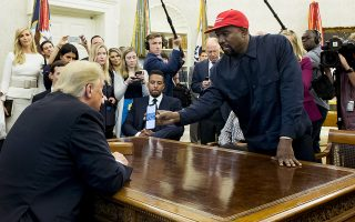 epaselect epa07086414 US entertainer Kanye West (R) shows a cell phone depicting the image of an aircraft to US President Donald J. Trump (L) during their meeting in the Oval Office of the White House in Washington, DC, USA, 11 October 2018. Kanye West, who is a Trump supporter, met with the President to discuss prison reform and other issues.  EPA/MICHAEL REYNOLDS