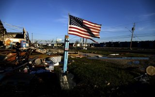 A U.S. flag flies in front of a building damaged by Hurricane Michael in Panama City, Florida, U.S. October 11, 2018. REUTERS/Jonathan Bachman