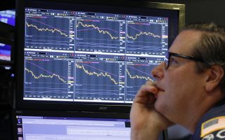 Specialist Gregg Maloney works at his post on the floor of the New York Stock Exchange, Wednesday, Oct. 10, 2018. Stocks are extending their slump on Wall Street, led by drops in big technology companies, as rising bond yields draw investors out of stocks. (AP Photo/Richard Drew)