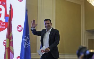 Macedonia's Prime Minister Zoran Zaev arrives to give a statement to members of the media about the referendum in Skopje, Macedonia, Sunday, Sept. 30, 2018. The crucial referendum on accepting a deal with Greece to change the country's name to North Macedonia to pave the way for NATO membership attracted tepid voter participation Sunday, a blow to Zaev's hopes for a strong message of support. (AP Photo/Boris Grdanoski)