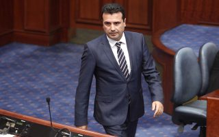 Macedonian Prime Minister Zoran Zaev arrives on a session of the Macedonian Parliament, in the capital Skopje, Friday, Oct. 19, 2018. Lawmakers in Macedonia have backed a landmark proposal to amend the constitution, allowing the country to change its name and join NATO. (AP Photo/Boris Grdanoski)
