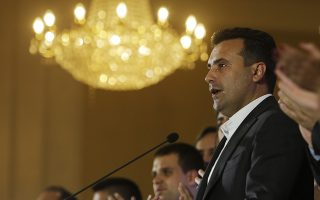 Macedonia's Prime Minister Zoran Zaev talks to members of the media during a news conference about the referendum in Skopje, Macedonia, late Sunday, Sept. 30, 2018. The crucial referendum on accepting a deal with Greece to change the country's name to North Macedonia to pave the way for NATO membership attracted tepid voter participation Sunday Sept. 30, a blow to Zaev's hopes for a strong message of support. (AP Photo/Boris Grdanoski)