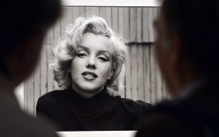Visitors look at Alfred Eisenstaedt's ™Marilyn Monroe, Hollywood, USA, 1953î during the