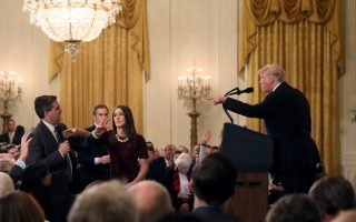 A White House staff member reaches for the microphone held by CNN's Jim Acosta as he questions U.S. President Donald Trump during a news conference following Tuesday's midterm U.S. congressional elections at the White House in Washington, U.S., November 7, 2018. REUTERS/Jonathan Ernst     TPX IMAGES OF THE DAY
