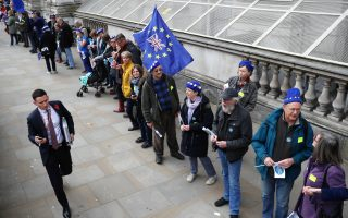 Demonstrators form a chain between Downing Street and the Houses of Parliament as they take part in a protest by groups representing EU citizens living in the UK, in Westminster, London, Britain, November 5, 2018. REUTERS/Simon Dawson