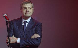 Russian businessman and President of AS Monaco football club, Dmitry Rybolovlev  poses during the celebration of the AS Monaco 2012-13 season and their come back in the French Premier League football for the next season, Friday, May 31, 2013, in Monaco. (AP Photo/Lionel Cironneau)