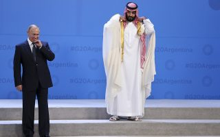 Russia's President Vladimir Putin, left, and Saudi Arabia's Crown Prince Mohammed bin Salman wait for other leaders to arrive for the G20 family photo at the Costa Salguero Center in Buenos Aires, Argentina, Friday, Nov. 30, 2018. (AP Photo/Ricardo Mazalan)