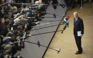 European Union chief Brexit negotiator Michel Barnier, right, speaks with the media as he arrives for an EU summit in Brussels, Sunday, Nov. 25, 2018. European Union leaders are gathering to seal an agreement on Britain's departure from the bloc next year, the first time a member country will have left the 28-nation bloc. (AP Photo/Olivier Matthys)
