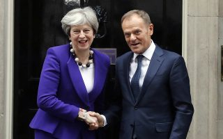 Britain's Prime Minister Theresa May greets EU Council President Donald Tusk at 10 Downing Street in London, Thursday, March 1, 2018. (AP Photo/Frank Augstein)