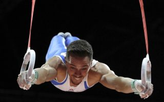 Eleftherios Petrounias of Greece on his way to winning the gold in the rings during the men's artistic gymnastics finals at the European Championships in Glasgow, Scotland, Sunday, Aug. 12, 2018. (AP Photo/Darko Bandic)