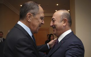 Turkey's Foreign Minister Mevlut Cavusoglu, right, greets Russia's Foreign Minister Sergey Lavrov, left, prior to their meeting in Istanbul, Saturday, Oct. 27, 2018. The Turkish and Russian foreign ministers met ahead of a summit on Syria by the leaders of Turkey, Russia, Germany and France to discuss the situation in the northwestern province of Idlib, access of humanitarian aid, the drafting of a constitution and reconstruction of the war-torn country. (Cem Ozdel/Turkish Foreign Ministry via AP, Pool)