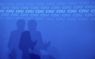 The shadow is seen of German Christian Democratic Party, CDU, chairwoman and Chancellor Angela Merkel,  during a news conference after a party's leaders meeting at the headquarters the in Berlin, Germany, Monday, Oct. 29, 2018. {Kay Nietfeld/dpa via AP)