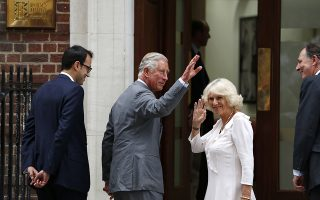 Britain's Prince Charles and his wife Camila, Duchess of Cornwall wave to well wishers as they arrive at St. Mary's Hospital exclusive Lindo Wing in London, Tuesday, July 23, 2013, where Kate, Duchess of Cambridge, gave birth to a baby boy on Monday July 22. The Royal couple are expected to head to London's Kensington Palace from the hospital with their newly born son, the third in line to the British throne. (AP Photo/Lefteris Pitarakis)