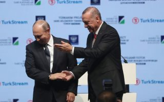 epa07177171 Turkish President Recep Tayyip Erdogan (R) and Russian President Vladimir Putin (L) shake hands after a Completion of the Offshore Section of the TurkStream Project at a ceremony in Istanbul, Turkey, 19 November 2018. TurkStream will directly connect the large gas reserves in Russia to the Turkish gas transportation network, to provide reliable energy supplies for Turkey, south and south-east Europe.  EPA/ERDEM SAHIN