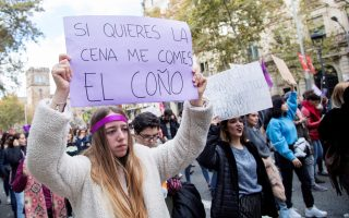 epa07189148 A woman raises a placards reading: 'If you want dinner you can eat my pussy' during one of the countrywide demonstrations held on the occasion of the International Day for the Elimination of Violence Against Women, in Barcelona, Spain, 25 November 2018.  Up to 44 women have died in Spain, killed by their partners during 2018, which brought the number of cases to 972 of women killed in the country since statistics started to study violence against women in 2003.  EPA/MARTA PEREZ