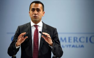 FILE PHOTO: Italian Minister of Labor and Industry Luigi Di Maio speaks at the Italian Business Association Confcommercio meeting in Rome, Italy, June 7, 2018. REUTERS/Tony Gentile/File Photo