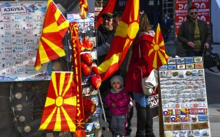 epa06500532 People look for souvenirs at a stall at the main square of the capital Skopje, The Former Yugoslav Republic of Macedonia, 06 February 2018. Prior to the resolution of the negotiations with Athens (Greece) on the name dispute, the public in Macedonia is eagerly awaiting the EU's strategy for the future of the Western Balkans.  EPA/GEORGI LICOVSKI