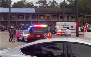 Emergency vehicles are parked outside the Hot Yoga studio at a shopping center where a guman opened fire in Tallahasee, Florida, U.S., November 2, 2018, in this still image taken from a video obtained from social media. Erin Vansickle/via REUTERS THIS IMAGE HAS BEEN SUPPLIED BY A THIRD PARTY. MANDATORY CREDIT. NO RESALES. NO ARCHIVES.
