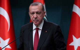 FILE PHOTO: Turkish President Tayyip Erdogan attends a news conference in Ankara, Turkey, August 14, 2018. REUTERS/Umit Bektas/File Photo