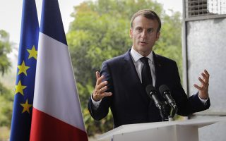 French President Emmanuel Macron speaks after visiting a farm in Morne-Rouge on the French Caribbean island of Martinique, Thursday, Sept. 27, 2018, as part of a four-day visit to the French Caribbean islands. (Thomas Samson, Pool via AP)