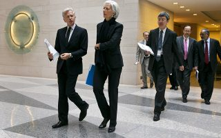 International Monetary Fund (IMF) Communications Director Gerry Rice, left, walks with IMF Managing Director Christine Lagarde to a news conference on the release of the concluding statement of the U.S. Article IV consultation, the IMF's annual check-up of the U.S. economy, Thursday June 4, 2015, at the IMF in Washington. (AP Photo/Jacquelyn Martin)