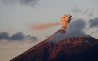 Volcan de Fuego or Volcano of Fire blows outs a thick cloud of ash in Antigua, Guatemala, early Friday, Nov. 16, 2018. (AP Photo/Moises Castillo)
