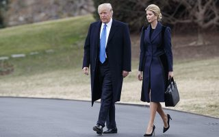 FILE - In this Feb. 1, 2017 file photo, President Donald Trump and his daughter Ivanka Trump walk to board Marine One on the South Lawn of the White House in Washington. Ivanka Trump is working out of a West Wing office and will get access to classified information, though she is not technically serving as a government employee, according to an attorney for the first daughter. (AP Photo/Evan Vucci, File)