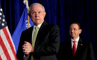FILE PHOTO: U.S. Attorney General Jeff Sessions (L) and Deputy Attorney General Rod Rosenstein arrive at a summit on crime reduction and public safety in Bethesda, Maryland, U.S., June 20, 2017. REUTERS/Yuri Gripas/File Photo